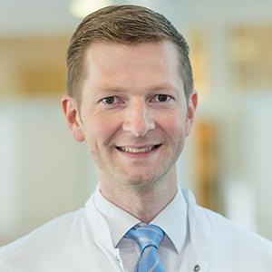 Dieses Bild zeigt ein Portrait von Herrn Dr. med. Benjamin Löh.